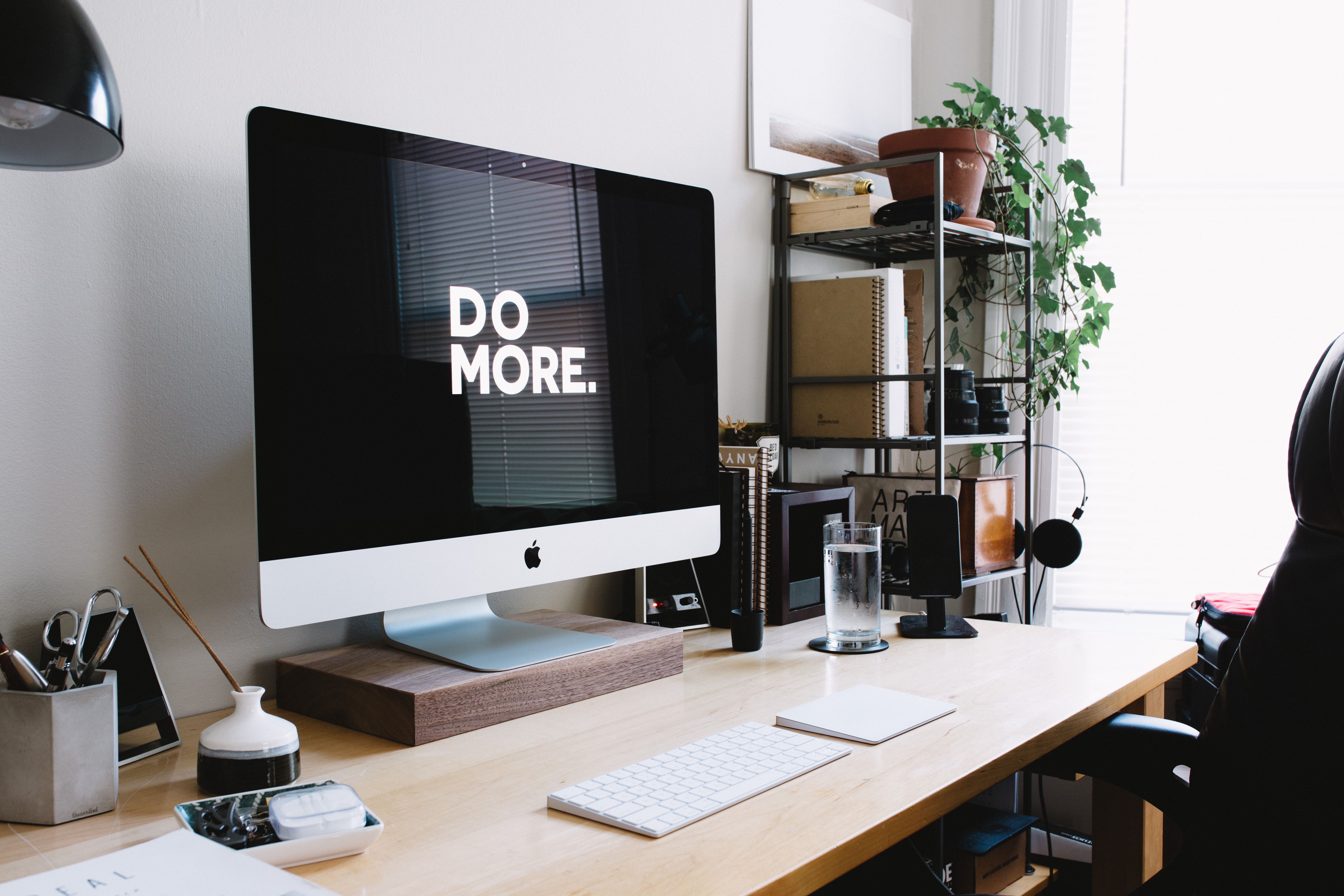 screensaver displaying 'Do More' on organized home office desk