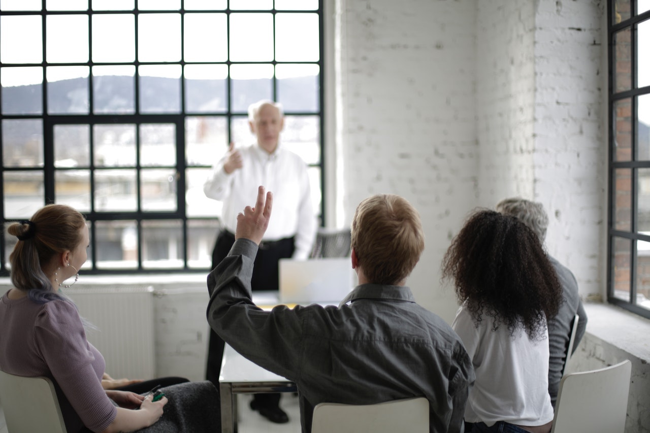 people-having-a-discussion-in-a-white-room-3931501